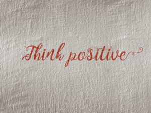 A sign that tells you to think positive