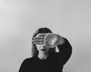A Woman Hiding Her Face
