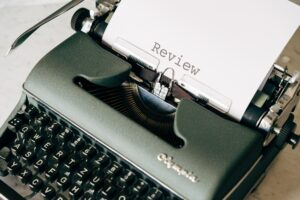 A typewriter with the word Review typed on it