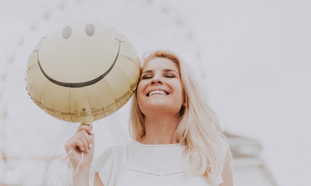 woman holding balloon // create tiny happiness