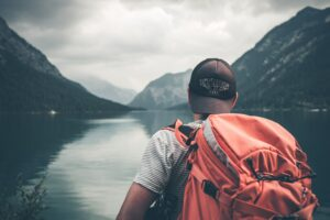 A Man Backpacking And Travelling