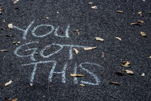 """A sign """"You Got This' written out in chalk"""