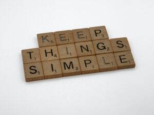 """The words """"Keep Things Simple"""" written in scrabble words"""