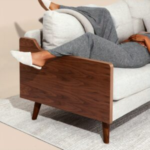 A person on the couch sitting very comfortably