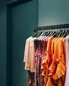 A wardrobe rack of different clothes for one person