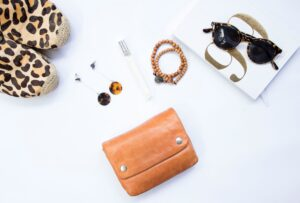 Different women's accessories, like shoes, make up, jewerly, and sunglasses