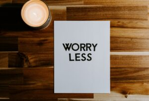 """A sign that says """"Worry Less"""""""
